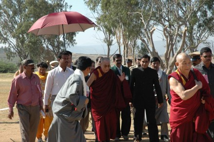 Dignitaries from the local Indian administration and representative of Dhondhenling Tibetan settlement escort His Holiness the Dalai Lama towards the official residence