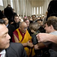 His Holiness the Dalai Lama being greeted by the public at the inter-faith prayer gathering. Photo by Ragnar Axelsson