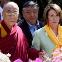 In this file photo His Holiness the Dalai Lama (L) welcomes US House of Representatives Speaker Nancy Pelosi (R) as she arrives at his Palace Temple in Dharamsala on 21 March 2008/AFP