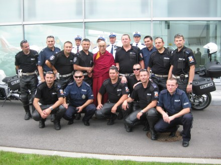 Polish motor cycle and escort care police officers also pose for the much cherished photo session with His Holiness the Dalai Lama.