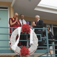His Holiness the 14th Dalai Lama (left) says a prayer after placing a white scarf over the wreath at the Lorraine Motel. The wreath is where Dr. Martin Luther King Jr. was killed by an assassin's bullet on April 4, 1968. The Rev. Samuel 'Billy' Kyles (center) described to his Holiness the moment Dr. King was shot. Kyles was just a few feet from Dr. King on that night. The Rev. Dr. Benjamin Hooks (right), a noted civil rights leader, also bows his head during a moment of silence. His Holiness and Dr. King are both recipients of the Nobel Peace Prize.