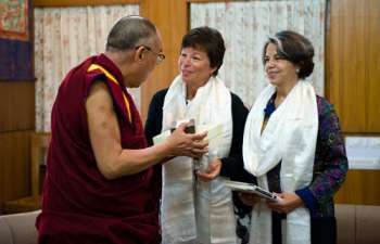 Left - US President Barack Obama's emissary, Valerie Jarrett (center) along with US State Department Under Secretary Maria Otero (right) talking to His Holiness the Dalai Lama during their meeting at the latter's residence in Dharamsala this morning