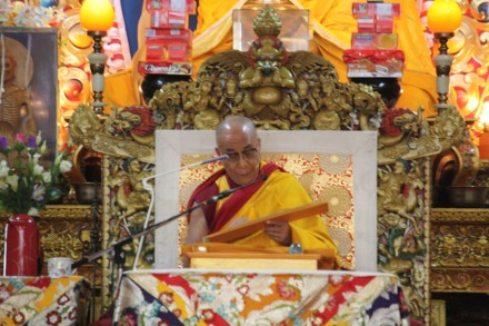 His Holiness the Dalai Lama reads texts from a scripture on the first day of a three-day Buddhist sermon  at Tsulagkhang, main temple, in Dharamsala, India, on 15 September 2009/Photo:Sangjay Kyap