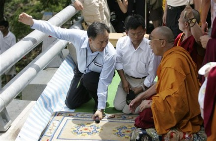 Exiled Tibetan spiritual leader the Dalai Lama, right, is shown the areas of devastation before praying for victims of Typhoon Morakot, at the destroyed village of Shiao Lin, in southern Taiwan, Monday, Aug. 31, 2009. (AP Photo/Wally Santana)