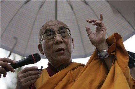 Exiled Tibetan spiritual leader the Dalai Lama prays for victims and comforts survivors of Typhoon Morakot, at the destroyed village of Shiao Lin, in southern Taiwan, Monday, Aug. 31, 2009. (AP Photo/Wally Santana)