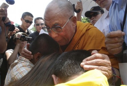 Tibetan spiritual leader the Dalai Lama blesses survivors of Shiao Lin, the village hardest-hit by massive mudslides triggered by Typhoon Morakot early this month,  Monday, Aug. 31, 2009, in Kaohsiung County, southern Taiwan.  (AP Photo/Chiang Ying-ying)
