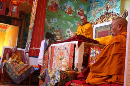 His Holiness the Dalai Lama (c) offers prayers for the four Tibetans who were executed by the Chinese government in Tibet and the victims of Iraq bomb blasts. His Eminence the 17th Gyalwang Karmapa (L) and His Eminence Menri Trizin Lungtok Tenpai Nyima (R) are also seen in the picture