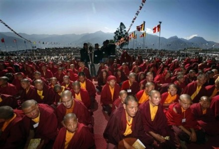Thousands of Buddhist devotees listen to Tibetan spiritual leader His Holiness the Dalai Lama during a preaching session in Tawang, in the northeastern Arunachal Pradesh state, India, Monday, 9 November 2009. (AP Photo/Manish Swarup)