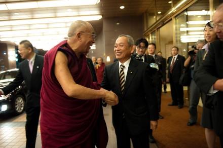 Makino Seishu (R) Member of Parliament, greets His Holiness the Dalai Lama (L) outside the  Royal Park Hotel.