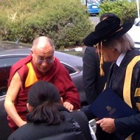 His Holiness the Dalai Lama is greeted by University of Tasmania Vice Chancellor Daryl Le Grew, this morning. Picture: Sally Glaetzer