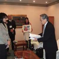 A representative of Tibet Support Group in Tokyo (L) submits a petition to a museum director, voicing their concerns about a recent exhibition on Tibet held in the capital, which they termed as Chinese government's propaganda.