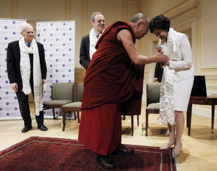 His Holiness presents a traditional scarf to Judy Shelton, Vice Chairman of the National Endowment for Democracy, after she presented him with the Democracy Service Medal.