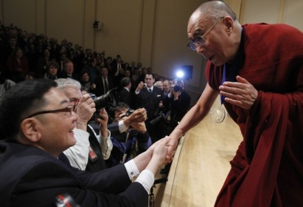 His Holiness shakes hands with audience members after receiving the National Endowment for Democracy's Democracy Service Medal during a ceremony at the Library of Congress in Washington,