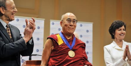 His Holiness the Dalai Lama (C) receives the National Endowment for Democracy's Democracy Service Medal during a ceremony at the Library of Congress in Washington, on 19 February 2010. The National Endowment for Democracy's President Carl Gershman (L) and Vice Chairman Judy Shelton clap after presenting the award/Photo: Office of His Holiness the Dalai Lama.
