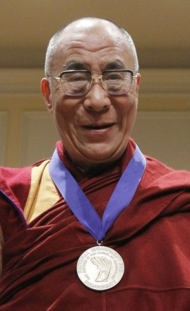 His Holiness The Dalai Lama smiles after receiving the National Endowment for Democracy's Democracy Service Medal during a ceremony at the Library of Congress in Washington, on 19 February 2010/REUTERS PHOTO