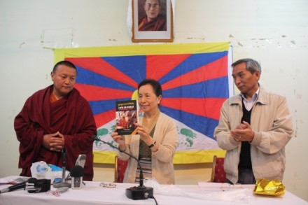 "Kalon Kesang Yangki Takla launches  ""Life in Exile - A Personal Story"" in Dharamsala on 16 March 2010, as book's author Ven Bagdro (left) and Secretary for International Relations Mr Tenzin Phuntsok Atisha (right) look on/Photo by Sangey Kyap"