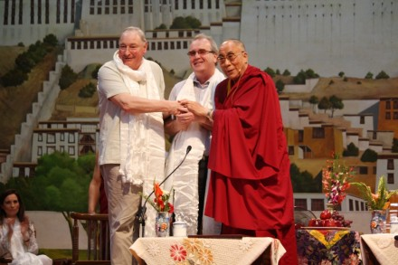 His Holiness the Dalai Lama helps Mr. Richard Moore (C) shook hands with Mr. Charles Inness (L) at a gathering at the TCV in Dharamshala on 5 May 2010
