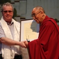 Mr. Richard Moore receives a citation and traditional Tibetan scarf from His Holiness