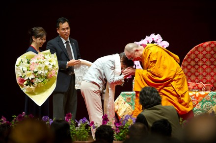 His Holiness the Dalai Lama greets a Japanese devotee during the teaching in Kanazawa in Japan, on 22 June 2010