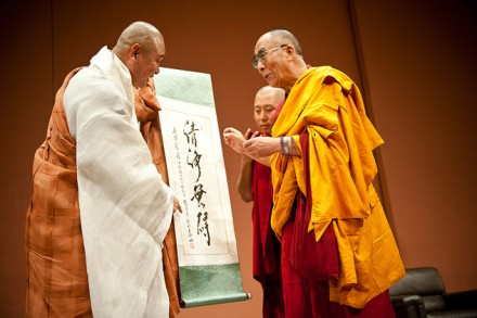 His Holiness the Dalai Lama (R) receives a special scroll from a Korean monk in Yokohama, Japan, on 27 June 2010/ Photos by Tenzin Choejor/OHHDL