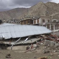 A collapsed building is seen after flash floods occurred in Leh/AP Photo