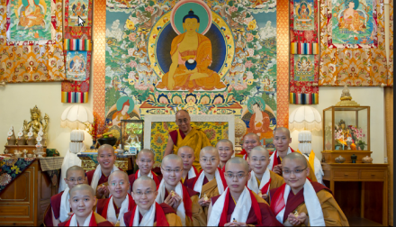 Newly ordained nuns in a group photo with His Holiness the Dalai Lama after the ordination ceremony in