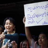 Aung San Suu Kyi addresses supporters outside her National League for Democracy party
