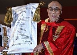 The Dalai Lama displays the honorary Doctor of Letters degree from Jamia Millia Islamia University