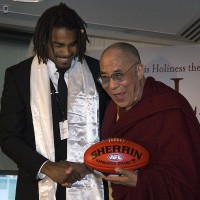 His Holiness the Dalai Lama is presented with an Australian Rules football by Harry O'brien in