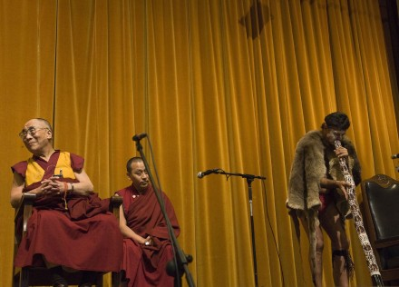 His Holiness the Dalai Lama enjoys a performance by an aborigine at an event in Perth, Australia, on