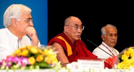 an spiritual leader the Dalai Lama (C), Indian Minister for Minority Affairs Salman Khurshid (L) and Chairman