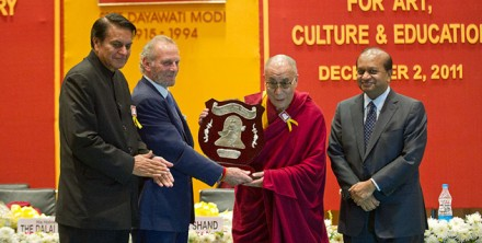 His Holiness the Dalai Lama receiving the Dayawati Modi Award for Art, Culture and Education in New Delhi,