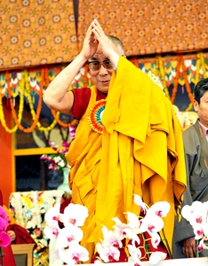 His Holiness the Dalai Lama gestures to the crowd as he wrapped up his ten-day Kalachakra teachings on January 10, 2012. Over 200,000 devotees attended the 32nd Kalachakra teachings in Bodh Gaya, India. (Phayul photo/Norbu Wangyal)