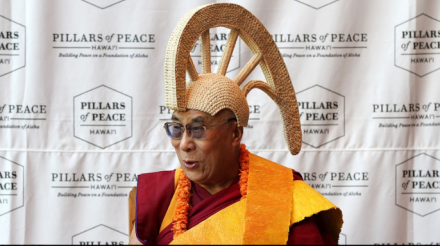 His Holiness wearing a mahi'ole – a traditional Hawaiin helmet made out of a gourd – presented to him during his visit to the Bishop Museum on Oahu, Hawaii, on 14 April 2012/Photo/Brian Tseng/Civic Beat