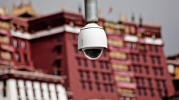 A surveillance camera is seen in Lhasa, Tibet, with the Potala Palace in the background in January 2011.