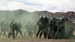 A unit from the Chinese People's Armed Police Force participates in a drill with riot gear at a military base in Shigatse, Tibet Autonomous Region, China on October 24, 2015. © 2015 Reuters